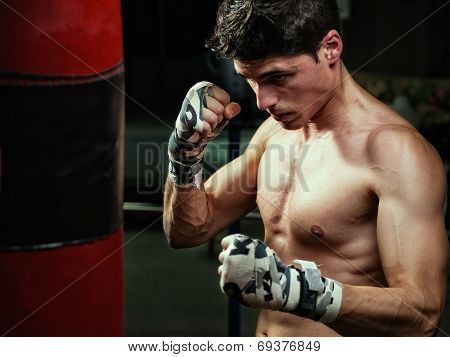 Young Caucasian Boxer Training With A Punching Bag