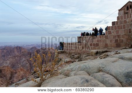 Tourists Meet Dawn On Mount Moses, Sinai Mountains, Egypt