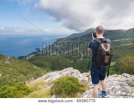 Photographer Sightseeing And Photographing A Beautiful Coastal Landscape