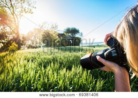 young blonde girl making photo