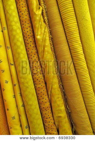 assortierte gelb Stoffe Hintergrund