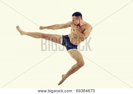 Young Muscular Boxer Fighter Doing Exercise With A Perfect Kick