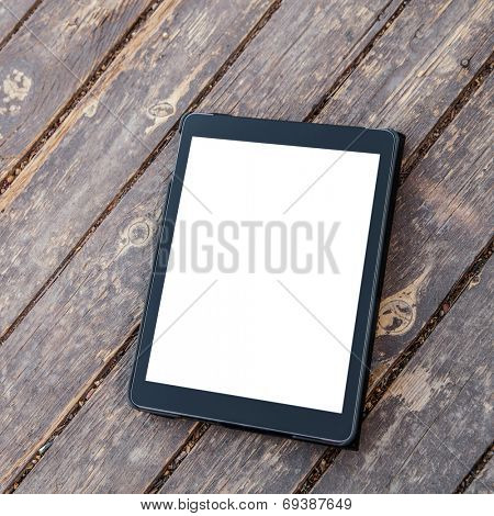Digital tablet computer with isolated screen on old wood.