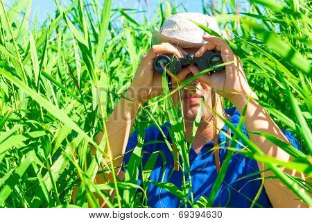 Man In An Ambush The Reeds With Binoculars