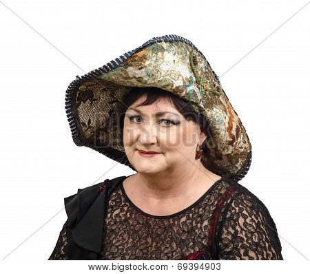 Mature Woman In Tapestry Hat Looking At Camera
