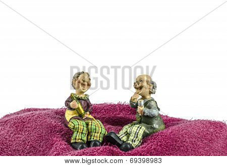 Grand Mom & Grand Dad Sit On Towel Moutain