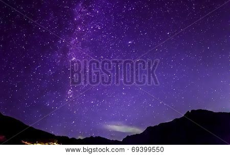 Purple Night Sky Stars. Milky Way Across Mountains