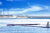 picture of hydroelectric  - hydraulic structure hydroelectric power station on the winter river - JPG