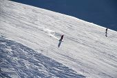 picture of sochi  - Skiers going down the slope at ski resort - JPG