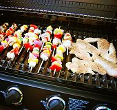 stock photo of braai  - a brand new grill with meat and vegetables on it - JPG