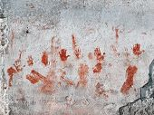 foto of bloody  - Red hands and smudges painted on a wall looking bloody - JPG