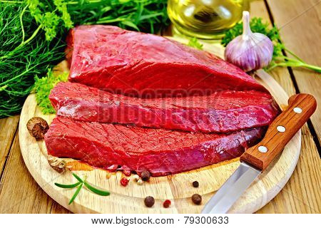 Meat beef on board with herbs and spices