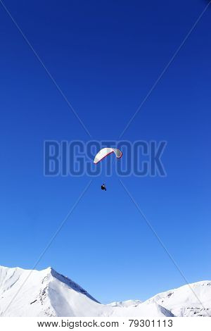 Paraglider In Snowy Winter Mountains At Sun Day
