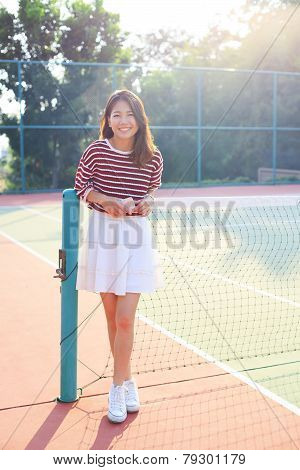 Portrait Of Beautiful Young Asian Woman Waearing White Clothes Skirt In Tennis Course With Happy Fac