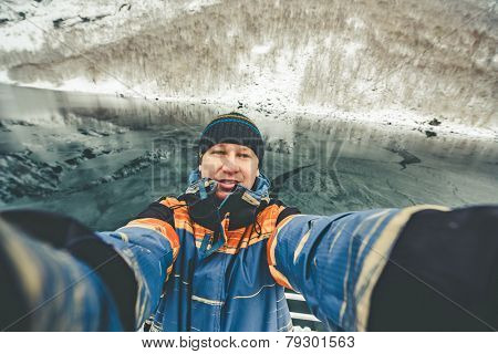 Seifie on beautiful mountain landscape with the Norwegian fjords in winter