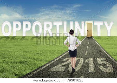 Female Worker Walking Toward An Opportunity Door