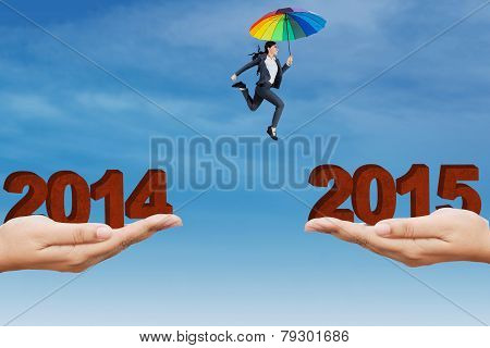Female Worker With Umbrella Jump Through A Slit