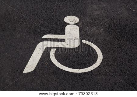only handicapped parking sign on the asphalt ground