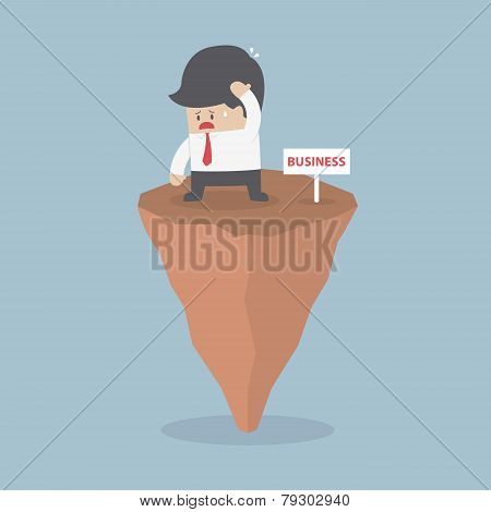 Businessman Standing On Unstable Rock, Business Risk Concept
