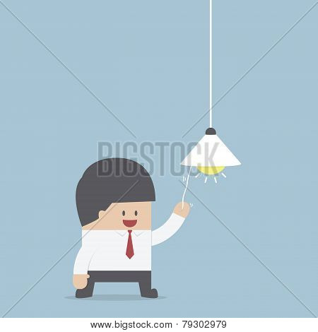 Businessman Switching On Light Bulb, Idea Concept
