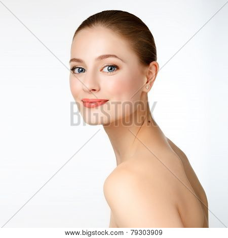 Portrait Of A Beautiful Young Girl Model With Clean Skin And Blue Eyes.