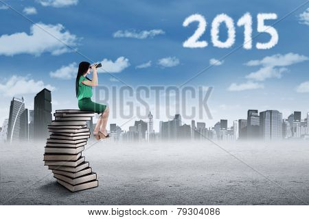 Woman Looking At Numbers 2015 With Binoculars