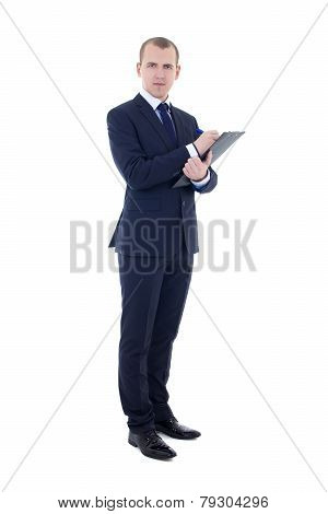 Full Length Portrait Of Young Businessman In Suit With Pen And Clipboard Isolated On White