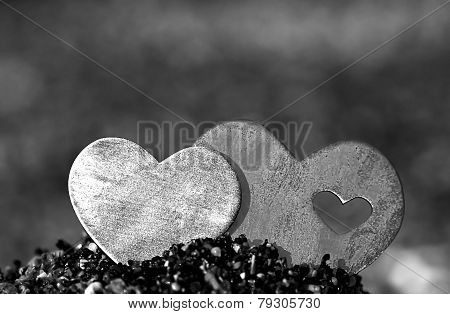 Two Hearts In A Sand Hill On A Rocky Beach