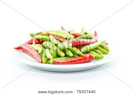 Drops Of Red And Green Cayenne Peppers On White Plate