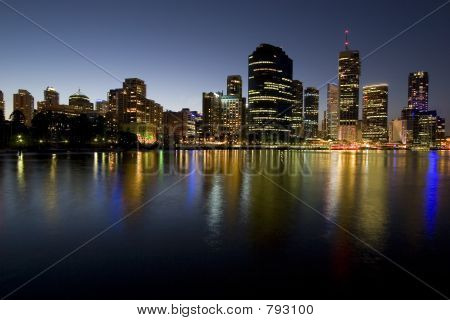 city skyline at dusk by river