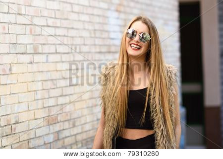 Happy Blonde Girl Smiling In Urban Background
