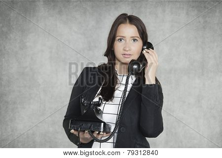 Pretty Secretary Talking On The Phone