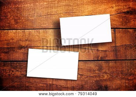 Blank Horizontal Business Cards On Wooden Table