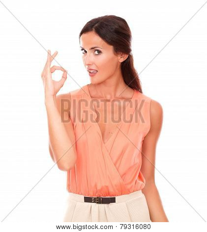 Cute Latin Woman Gesturing A Great Job