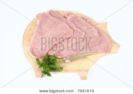 Chuletas de cerdo cruda ablandada