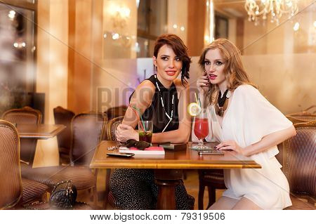 Two Young Women In A Bar