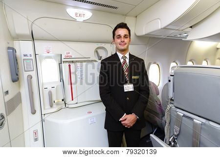 DUBAI - OCT 17: Emirates crew member in Airbus A380 aircraft on October 17, 2014 in Dubai, UAE. Emirates handles major part of passenger traffic and aircraft movements at the airport.