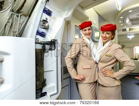 DUBAI - OCT 17: Emirates crew members meet passengers in Airbus A380 aircraft on October 17, 2014 in Dubai, UAE. Emirates handles major part of passenger traffic and aircraft movements at the airport.