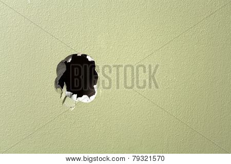 hole wall green background