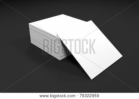 Stack Of White Paper Cards On Office Desk