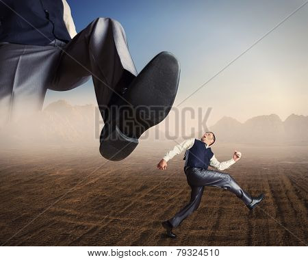 Businessman runs from a big foot