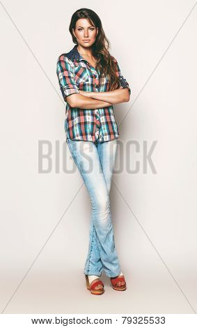 Tall Woman In Check Shirt And Jeans