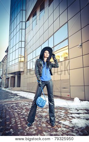 Attractive young woman in a winter fashion shot. Beautiful fashionable young girl