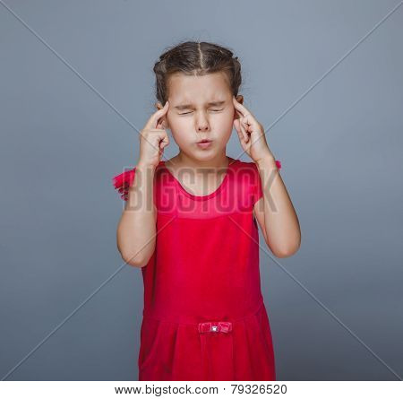 girl child migraine headache on a gray background