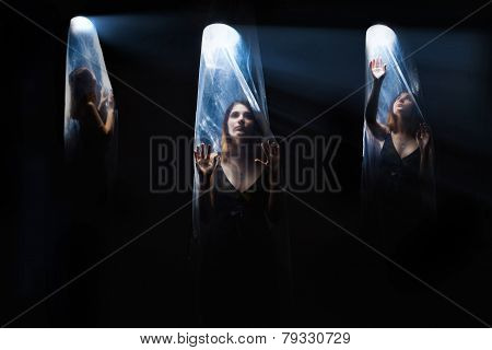 agoraphobia 3 girls woman inside a plastic bag,  bright light