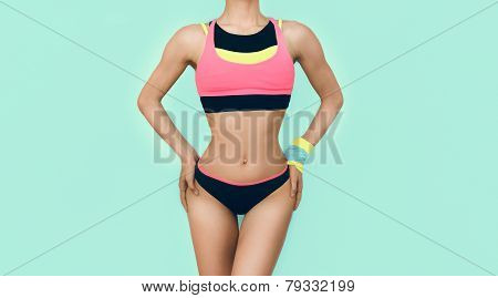 Slim Athletic Girl In Bright Trendy Sport Clothes On Blue Background
