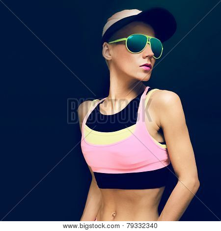 Fitness Girl In Bright Trendy Sport Clothes On A Black Background. Sports Fashion Accessories
