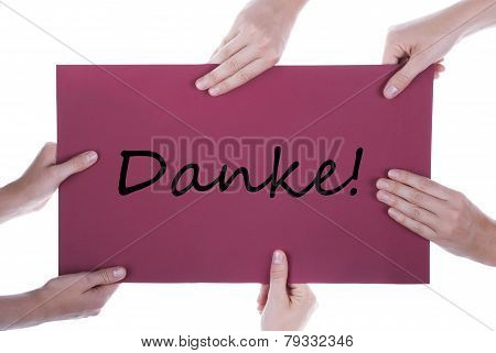 Many Hands Holding A Paper With Danke