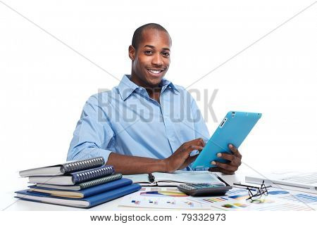 Black man working in office with tablet computer.  Accounting