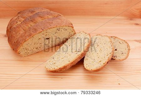 Three Slices Of Fresh Bread Next To The Loaf